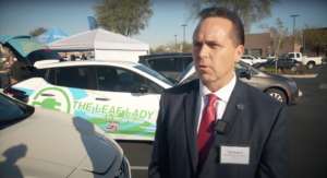 Assemblyman Tom Roberts stands in front of a Nissan Leaf (pre-pandemic) while summarizing the economic benefits of electric vehicles and clean energy in Nevada.
